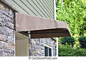 Small Awining Over Door - A small canvas awning over an...