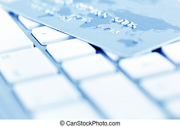 Computer keyboard and credit card - On the keyboard of a...