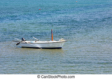 Rowboat - Lonely wooden fishing rowboat on the sea
