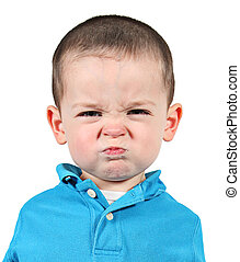 Cute little boy making funny faces on white background