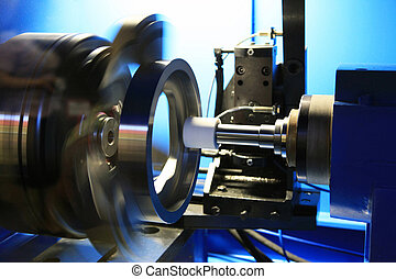 Grinding of a round detail on the special machine tool with...
