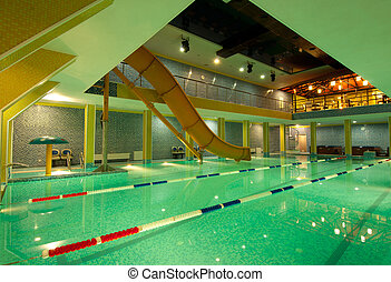 aquatic center with an artificial hill for skiing