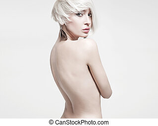 Vogue style photo of a naked woman