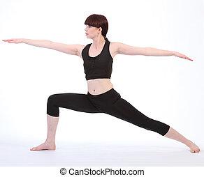 Exercising Yoga Warrior Two pose Virabhadrasana - Yoga...