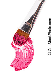 Pink lipstick stroke (sample) with makeup brush, isolated on...