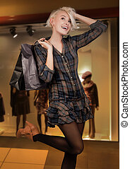 Happy young woman shopping