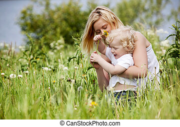 Mother and Son in Grass Field - A mother and son having fun...