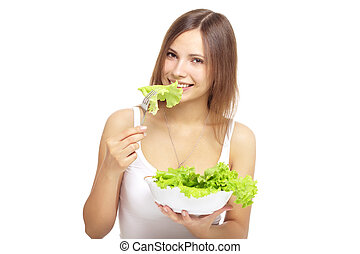 Young woman eating healthy salad isolated on a white...
