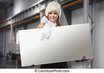 Smiling girl holding white blank
