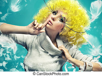 Fine art photo of a girl on the blue background
