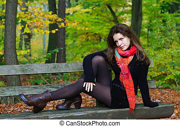 young woman in autumn park - Portrait of young woman in...