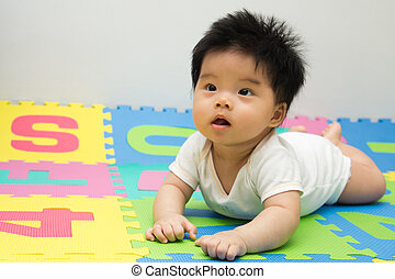 Little baby crawling on floor