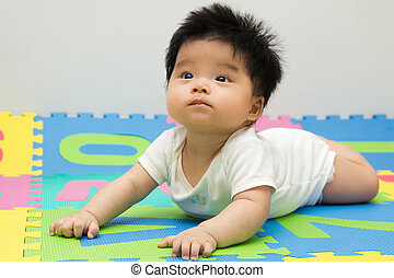 Little baby crawling on floor - Portrait of a little Asian...