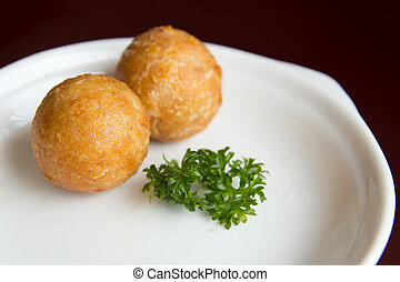 Yam balls - Deep fried yam balls served in a white plate