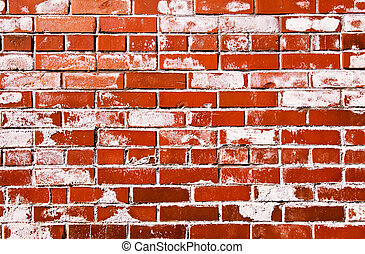 Bright red grungy brick wall with white coating stamps