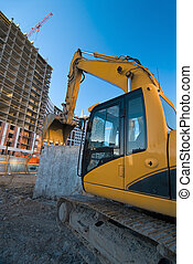 excavator at the construction place - resting excavator at...