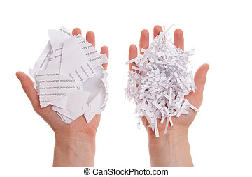 Shredded paper in hand - Shredded paper, security white pile...