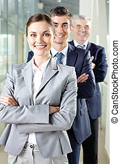 Happy leader - Smiling businesswoman looking at camera with...