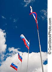 Four waving Russian flags