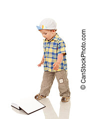 boy playing with a blank book