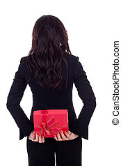 businesswoman holding a present on her back