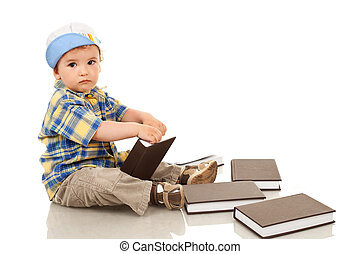 little boy playing with some books