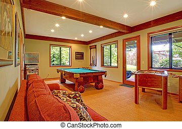 Guest house with kitchen and red sofa - Guest house living...
