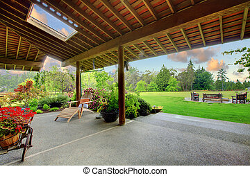 Back yard with covered deck and green garden