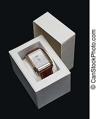 Watch - gold watch in a box on a dark blue background