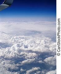 Flying high above the earth. - Aerial view of sky from...