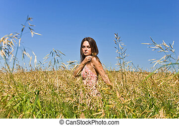 Beautiful young woman in a field of rye Touch the ears...