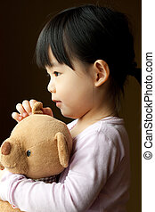 Small little kid with teddy bear - Little girl holding a...