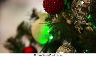 Christmas balls hanging on fir-tree