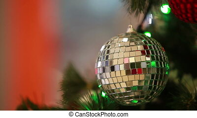 Specular ball hanging on Christmas-tree
