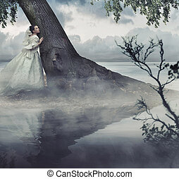 Fine art photo of a woman in beauty scenery