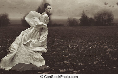 Running woman over nature background in black and white