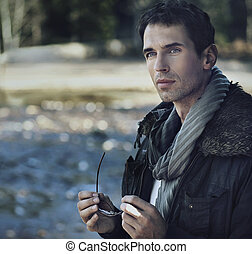 Outdoors portrait of a young man