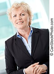 Confident woman - Portrait of smiling middle aged...