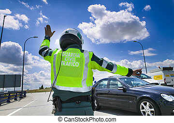 Guardia civil, spanish road traffic police, stopping a car...