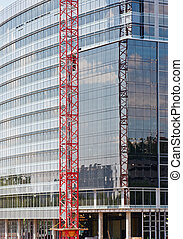 Red Crane in Front of Glass Construction