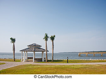 Pavilion and Palm Trees on Coast by Pier