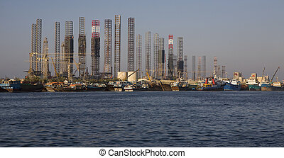 Drilling rig and vessels in the port