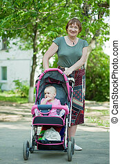 Mature woman with pram