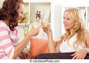 two women celebrating at home