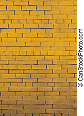Background with old yellow painted brick wall - The...