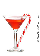red martini with a candy cane - isolated red martini with a...