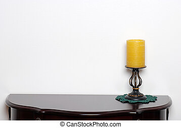 Table with a wax candle lamp