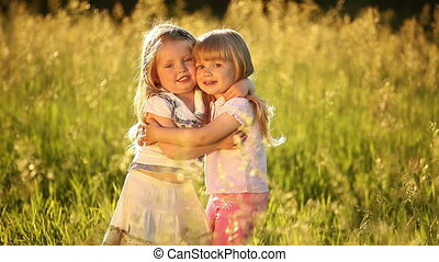 Two sisters hugging