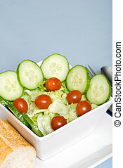 tossed salad closeup with blue background