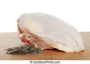 uncooked chicken breast rosemary - closeup uncooked chicken...
